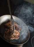 Steak cooking on grille pan. Fresh, delicious, spicy meat on a k Royalty Free Stock Image