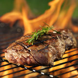Steak Cooking Over Flaming Grill Royalty Free Stock Photo