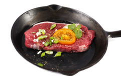 Steak cooking in pan Royalty Free Stock Images
