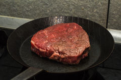 Beef steak cooking Royalty Free Stock Image