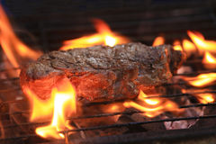 Steak on flame Grill Stock Photo