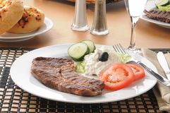 Steak and cottage cheese Stock Images