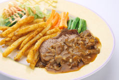 Steak cuisine. Steak dinner with mushroom sauce Royalty Free Stock Photo