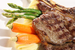 Steak dinner. Beef steak dinner with vegetables and gravy Royalty Free Stock Photo