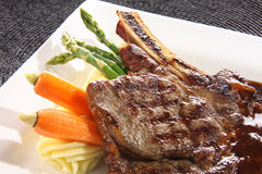 Steak dinner. Beef steak dinner with vegetables and gravy Stock Images