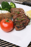 Steak Dinner. Grilled steak dinner with potato, and vegetables Stock Image