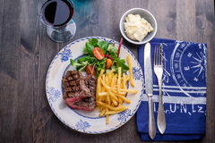 Steak dinner with fries and sauce Stock Image