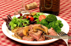 Steak dinner, salad and wine Royalty Free Stock Photos