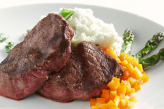 Steak Dinner. Steaks, mashed potatoes, peppers, and asparagus make an appealing dinner Stock Images