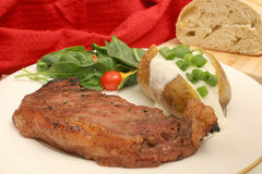 Steak dinner on white Royalty Free Stock Photos