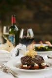 Steak dinner on white plate. Stock Image