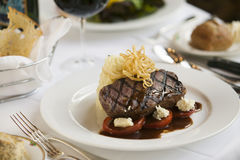 Steak dinner on white plate. Stock Photos