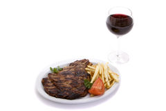 Steak dinner and wine Royalty Free Stock Images