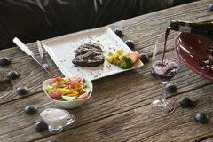 Steak dinner on wooden table Royalty Free Stock Image