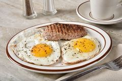 Steak and egg breakfast. A steak and egg breakfast with a cup of coffee royalty free stock photography