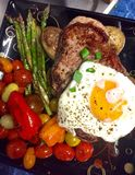 Steak with egg and vegetables Royalty Free Stock Photo