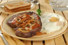 Steak and eggs Royalty Free Stock Image