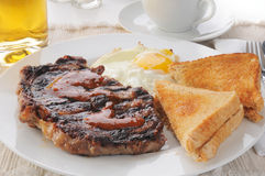 Steak and eggs Stock Photos