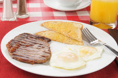 Steak and eggs. Grilled steak and egg breakfast with toast stock photo