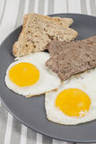 Steak and eggs with toast Royalty Free Stock Photography