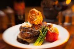 Steak entree on a white plate. Steak dinner entree on a white plate at a restaurant Stock Images