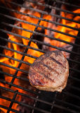 Steak on Fiery Grill. Steak cooking over flaming grill Stock Photos