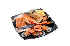 Steak with fish, mussels and prawns Royalty Free Stock Photography