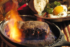 Steak flambée Royalty Free Stock Images