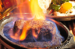 Steak flambe Stock Photo