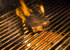 Steak on a Flaming Grill Royalty Free Stock Photography