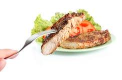 Steak on fork Stock Photography