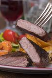 Steak on a fork. With vegetables Royalty Free Stock Photos