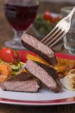 Steak on a fork. With vegetables Royalty Free Stock Photography