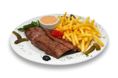 Steak with french fries. Grilled beef steak with french fries and sauce served in plate. isolated Royalty Free Stock Image