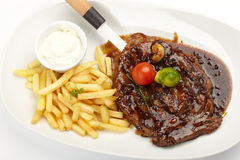 Steak with French Fries Royalty Free Stock Photo