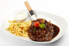 Steak with French Fries Stock Photos