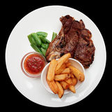 Steak with french fries, isolated Royalty Free Stock Images