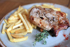 Steak with french fries Royalty Free Stock Images