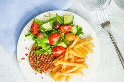 Steak with french fries and salad Stock Photo