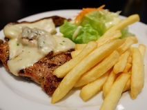 Steak with French fries Stock Images