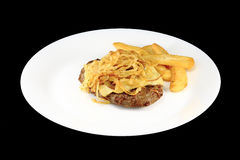 Steak and Frenchfries. Steak and french fries in a white dish royalty free stock images