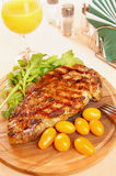 Steak with fresh greenery and tomatoes Royalty Free Stock Photo