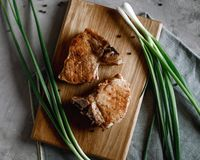 Steak with fresh onions. Juicy pork steak grilled with onions royalty free stock photo
