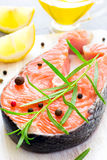 Steak of fresh salmon with aromatic herbs and spices close-up Stock Image