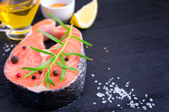 Steak of fresh salmon with aromatic herbs and spices. copy space Royalty Free Stock Image