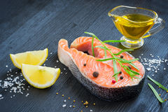 Steak of fresh salmon with aromatic herbs and spices. healthy fo Stock Photo