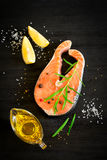 Steak of fresh salmon with aromatic herbs and spices. Top view Royalty Free Stock Photography