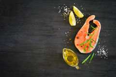 Steak of fresh salmon with aromatic herbs and spices. Top view w Royalty Free Stock Photography