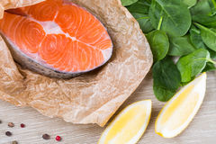 Steak of fresh salmon on crushed brown paper Royalty Free Stock Photo