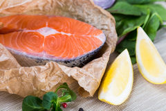 Steak of fresh salmon on crushed brown paper Royalty Free Stock Image